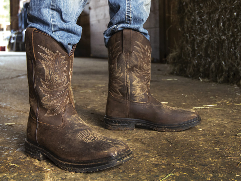 man wearing rocky mens western cowboy work boots