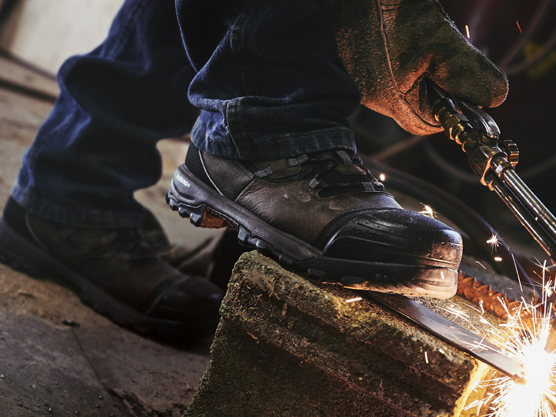 work boots for men, worker with torch wearing rocky xo-toe composite toe men's work boots